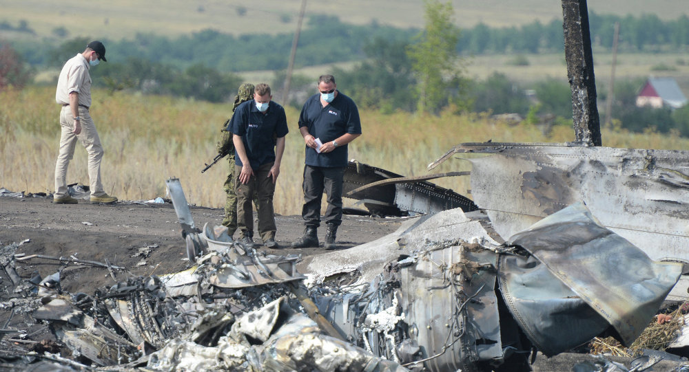 OSCE employees and experts work at Malaysia Airlines Boeing 777 crash site