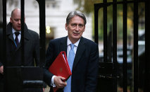 Foreign Secretary Philip Hammond arrives in Downing Street on November 19, 2014 in London, England.