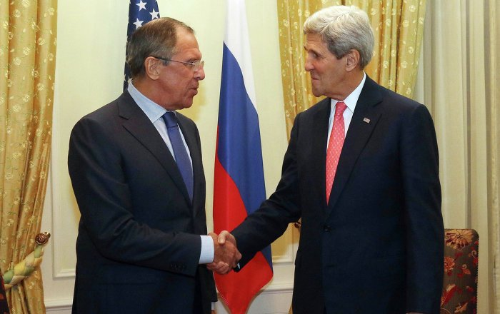 Russian Foreign Minister Sergey Lavrov (L) and U.S. Secretary of State John Kerry (R) shake hands as they pose for a photograph prior to a bilateral meeting on the sidelines of the closed-door nuclear talks with Iran