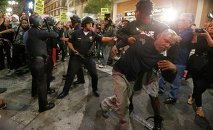 Police face off against protesters as they corral them before making mass arrests in Los Angeles, California