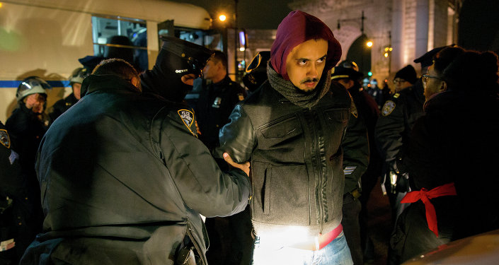 A person is taken into custody at the Manhattan side of the Manhattan Bridge Thursday, Dec. 4, 2014, in New York