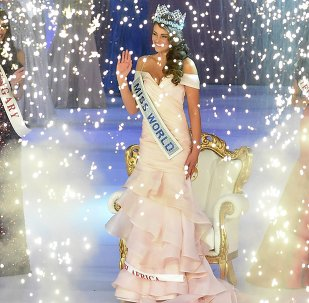 Rolene Strauss of South Africa (C) is crowned Miss World 2014, as Elizabeth Safrit of the U.S. (R) and Edina Kulczar of Hungary (L) who placed third and second respectively, look on at the ExCel Centre in east London, December 14, 2014.
