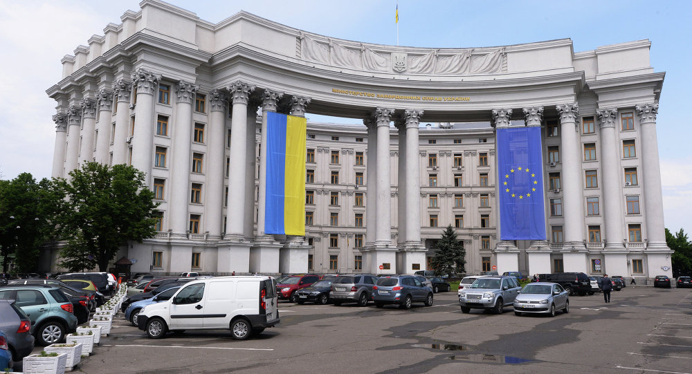 The building of Ukraine's Interior Ministry with flags of Ukraine and EU displayed on its facade.