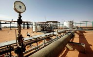 Pipes are pictured at the El Sharara oilfield December 3, 2014