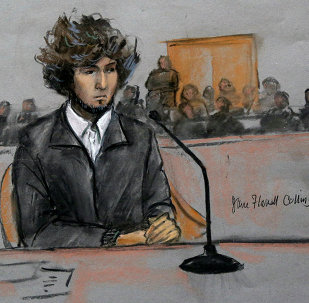 In this courtroom sketch, Boston Marathon bombing suspect Dzhokhar Tsarnaev is depicted sitting in federal court in Boston Thursday