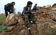 Fighters from the Al-Nusra Front, Al-Qaeda's Syria branch, hold a position as they fight against forces loyal to the regime