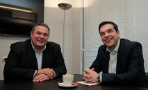 Head of radical leftist Syriza party Alexis Tsipras (R) meets with leader of right-wing, anti-bailout Independent Greeks party Panos Kammenos at party headquarters in Athens, January 26, 2015. Syriza party will form a coalition government with Independent Greeks party, Kammenos told reporters on Monday