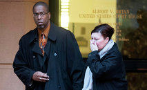 Former CIA officer Jeffrey Sterling leaves the Alexandria Federal Courthouse, Monday, Jan. 26, 2015, in Alexandria, Va., with his wife, Holly, after being convicted on all nine counts he faced of leaking classified details of an operation to thwart Iran's nuclear ambitions to a New York Times reporter.
