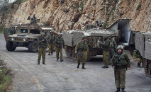 Israeli soldiers secure the Israel-Lebanon Border, Wednesday, Jan. 28, 2015