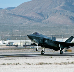 An F-35 Lightning II lands Wednesday, March 6, 2013, at Nellis Air Force Base
