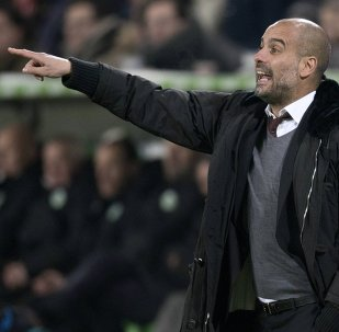 Bayern Munich coach Pep Guardiola shouts to his players during their German first division Bundesliga soccer match against VfL Wolfsburg, in Wolfsburg January 30, 2015
