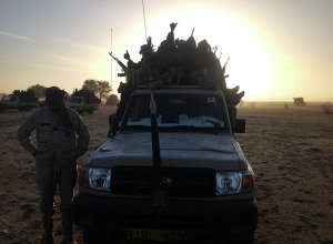 Soldiers of the Chadian army guard on January 21, 2015, at the border between Nigeria and Cameroon, some 40 km from Maltam, as part of a military contingent against the armed Islamist group Boko Haram.