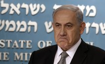 Israeli Prime Minister Benjamin Netanyahu gestures during a press conference in Jerusalem, Tuesday Dec. 2, 2014.