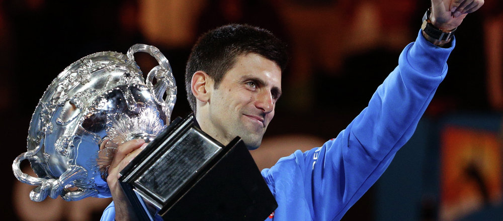 Novak Djokovic of Serbia holds the trophy after defeating Andy Murray of Britain in the men's singles final at the Australian Open tennis championship in Melbourne, Australia