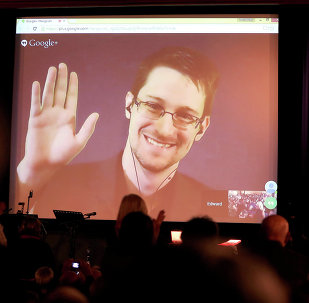 Edward Snowden, pictured here accepting the 2014 Carl von Ossietzky Medal via livestream in Berlin, was the fourth most admired man in Germany, according to a YouGov poll.