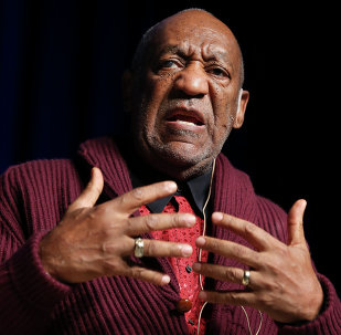 comedian Bill Cosby performs at the Stand Up for Heroes event at Madison Square Garden in New York. Three women who claim they were victimized by Cosby are scheduled to appear at a news conference called by attorney Gloria Allred, on Wednesday, Dec. 3, 2014.