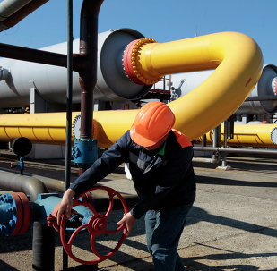 Ukrainian worker operates a valve at a gas storage point in Bil 'che-Volicko-Ugerske underground gas storage facilities in Strij, outside Lviv, Ukraine