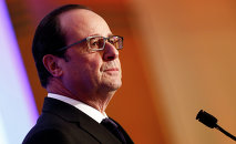 French President Francois Hollande pauses, as he delivers his speech at the 30th annual dinner held by the French Jewish Institutions Representative Council