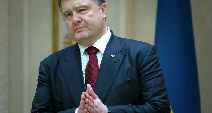 Ukrainian President Petro Poroshenko gestures as he speaks to the media after the peace talks in Minsk, Belarus