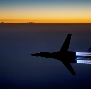 a fighter jet flies over northern Iraq after conducting airstrikes in Syria against Islamic State group targets in Syria