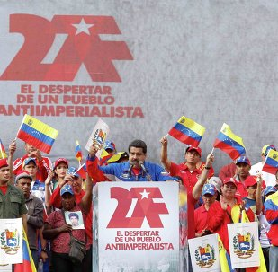 Venezuela's President Nicolas Maduro (C) speaks during a rally to commemorate the 26th anniversary of the social uprising known as 'Caracazo', which Venezuela's late President Hugo Chavez said marked the start of his revolution, in Caracas in this February 28, 2015 picture provided by Miraflores Palace.