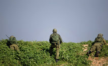 Israeli soldiers take position near the Israel-Lebanon Border, northern Israel