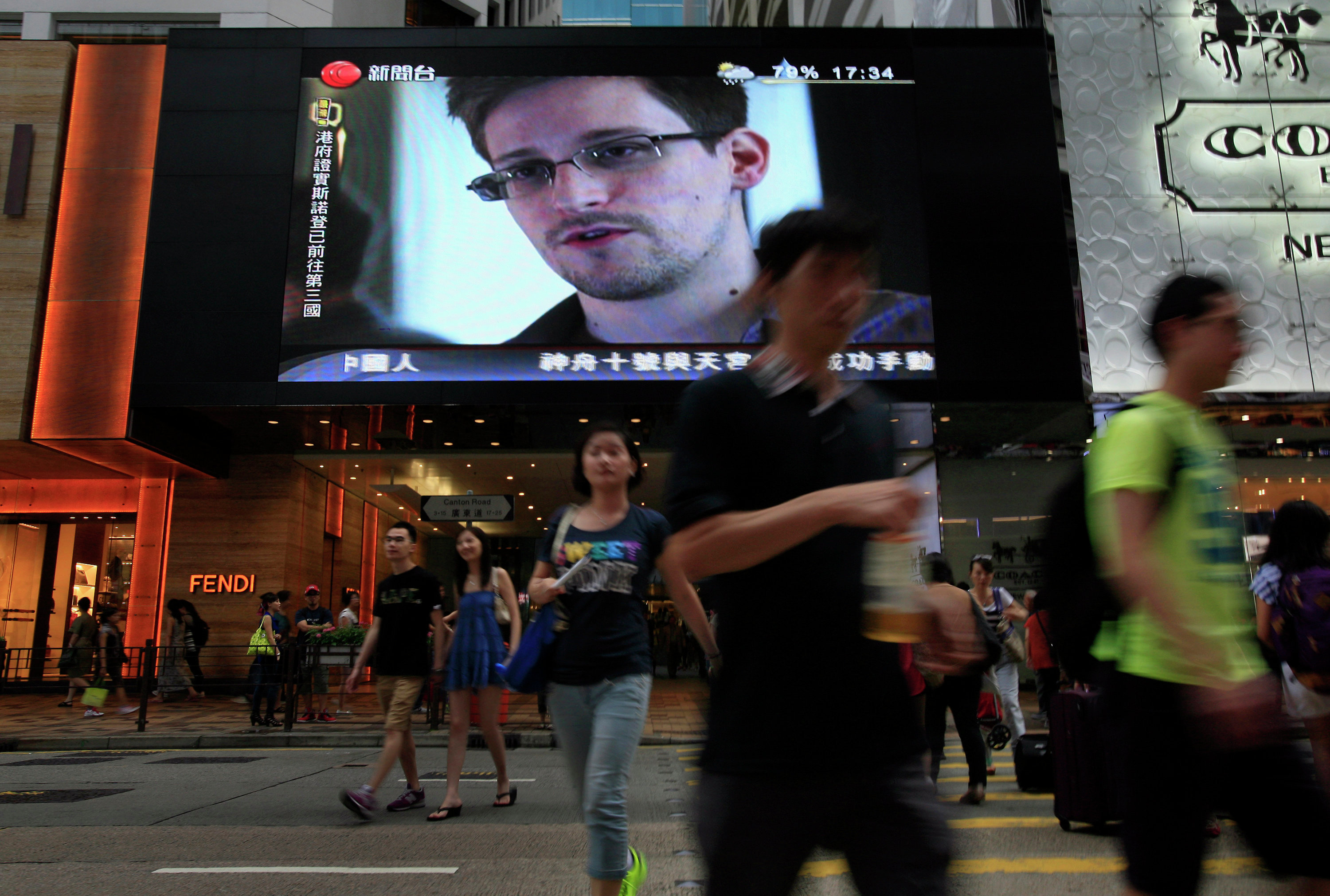 A TV screen at a shopping mall in Hong Kong shows a news report of former CIA employee and NSA whistleblower Edward Snowden.