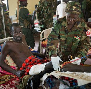 In this December 2013 file photo, a patient is treated by a military doctor in a ward at the Juba Military Hospital in Juba, South Sudan.