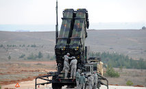 US soldiers work on a Patriot missile system
