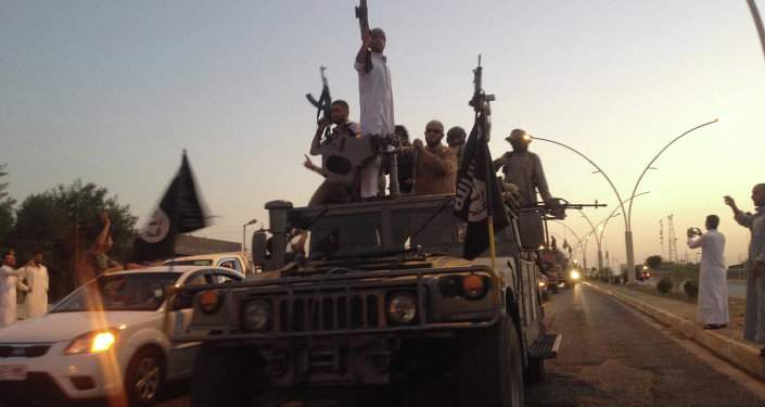 ISIL fighters parade through Mosul, Iraq in 2014. File photo