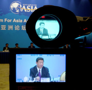China's President Xi Jinping is shown on the screens of a TV camera during his meeting with representatives of entrepreneurs at the annual Boao Forum for Asia