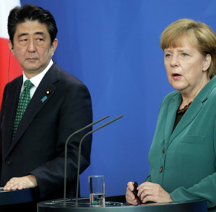 German Chancellor Angela Merkel and Prime Minister of Japan Shinzo Abe address the media during a joint press conference as part of a meeting at the chancellery in Berlin.