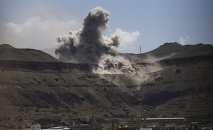 Dust rises from the site of army weapons depots hit by an air strike in Sanaa