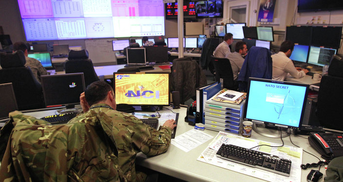 Staff operate at the NATO Computer Incident Response Capability (NCIRC) technical center, at NATO's military headquarters SHAPE in Mons, southwestern Belgium, Tuesday, Dec. 10, 2013. The NCIRC protects NATO systems and information from any form of attack and from deliberate or accidental exposure.