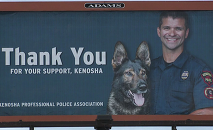 The Kenosha Professional Police Association billboard featuring Office Pablo Torres who is under investigation for shooting 10 people over the course of a 10-day period