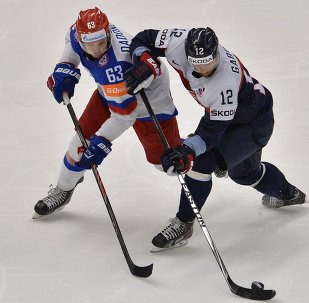Russian ice hockey team Sunday won the next-to-last preliminary round's match at the World Championship against Slovakia in overtime 3-2 and guaranteed itself a playoff spot.