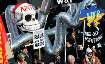 Demonstrators take part in a protest titled There is no Peace with NATO in front of the venue of the 51st Munich Security Conference (MSC) in Munich, southern Germany.