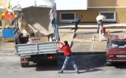 A vehement wind knocked workers off their feet and nearly turned a truck over in Russia.