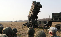 In an article for bimonthly academic journal Nowa Europa Wschodina, Polish political scientist Kuba Benedyczak explained that in the context of the new arms race emerging between NATO and Russia, Poland's decision to accept US missile defense is akin to asking Poles to put their heads between a hammer and an anvil.