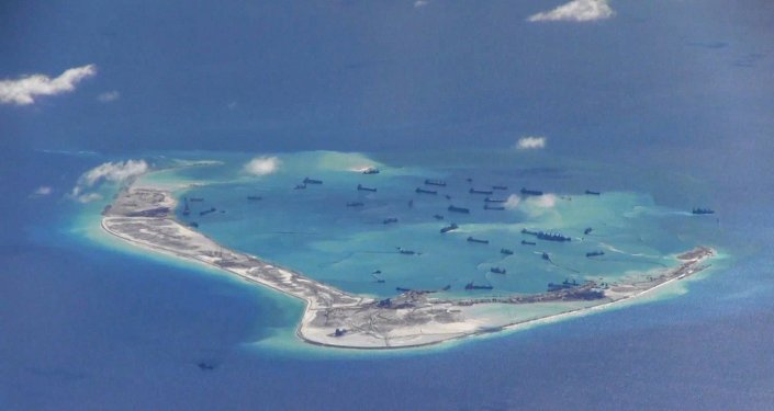 Chinese dredging vessels are purportedly seen in the waters around Mischief Reef in the disputed Spratly Islands in the South China Sea, in this file still image from video taken by a P-8A Poseidon surveillance aircraft and provided by the United States Navy on May 21, 2015
