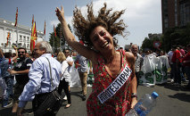 A woman dances while protesting in front of the Government building in Skopje, Macedonia