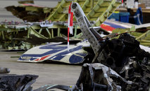 Parts of the wreckage of the Malaysia Airlines Flight 17 are displayed in a hangar at Gilze-Rijen airbase, Netherlands