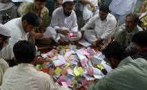 Pakistani presiding officers count ballots in Peshawar on May 30, 2015