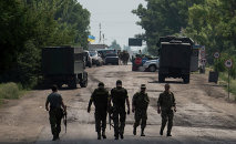 Ukrainian servicemen from battalion Kiev1 walk outside a checkpoint near Marinka, Donetsk region, eastern Ukraine