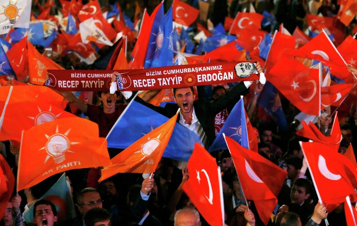 Supporters wave Turkish national and party flags outside the AK Party headquarters in Ankara, Turkey, June 7, 2015