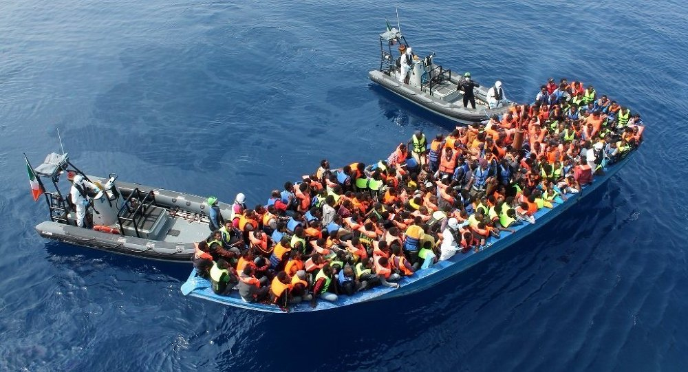 Officers of the Irish Navy ship Le Eithne rescue migrants in the Mediterranean Sea.