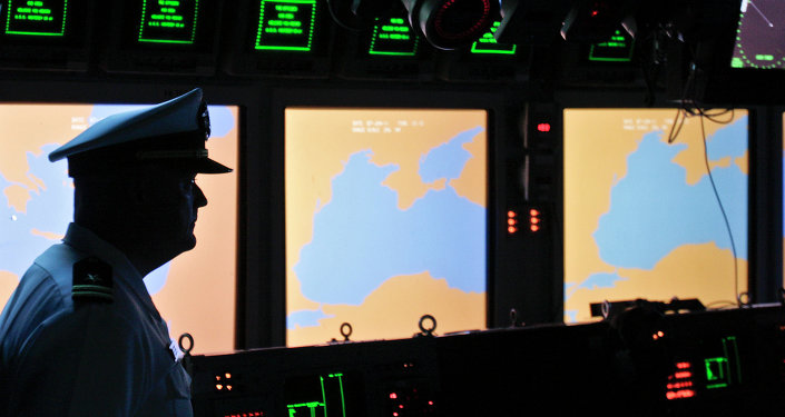 A US Navy officer, name not available, looks on at the weapons control deck of the USS Monterey in the Black Sea port of Constanta, Romania, Tuesday, June 7, 2011