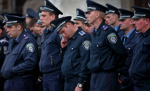 Police troops guard the burnt trade union building in Odessa, Ukraine, Saturday, May 3, 2014