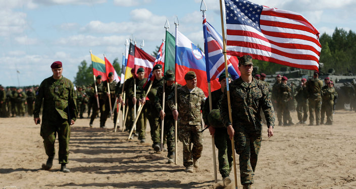 Soldiers from NATO countries attend an opening ceremony of military exercise 'Saber Strike 2015'.
