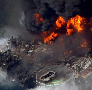 In this April 21, 2010 file photo taken in the Gulf of Mexico more than 50 miles southeast of Venice on Louisiana's tip, the Deepwater Horizon oil rig is seen burning